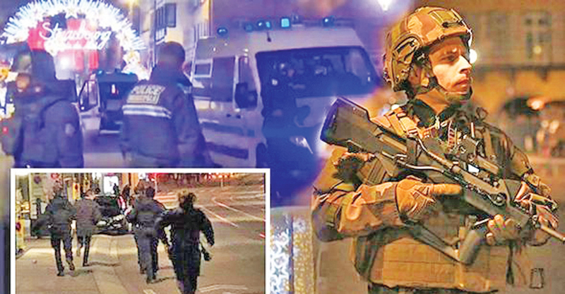 Police patrol the city of Strasbourg after the shooting.