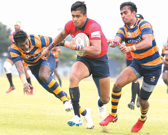 A CR and FC player makes a break hotly pursued by two Army SC players in their Dialog 'A' division league rugby match played at Air Force Grounds, Ratmalana yesterday which ended in a 24 all draw.Picture by Samantha Weerasiri