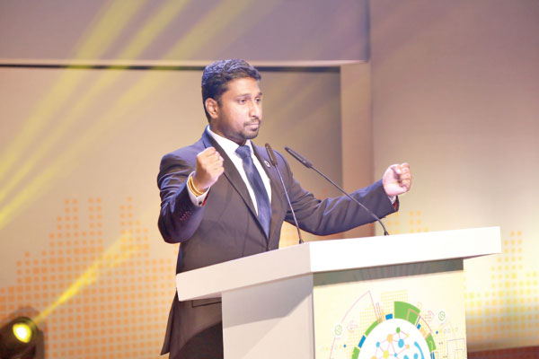 Dr. Ashan Perera, UN SDG Action Award Winner 2018, Youth Advocate, Social Entrepreneur and Founder of The Road to Rights Youth-Led Organization addressing the gathering