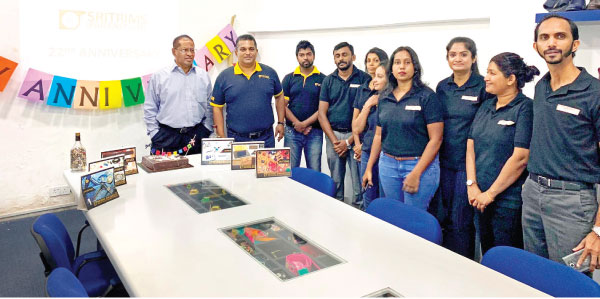 Managing Director, Sritrims, Nishantha Delgoda, with his team during the 22nd anniversary celebrations
