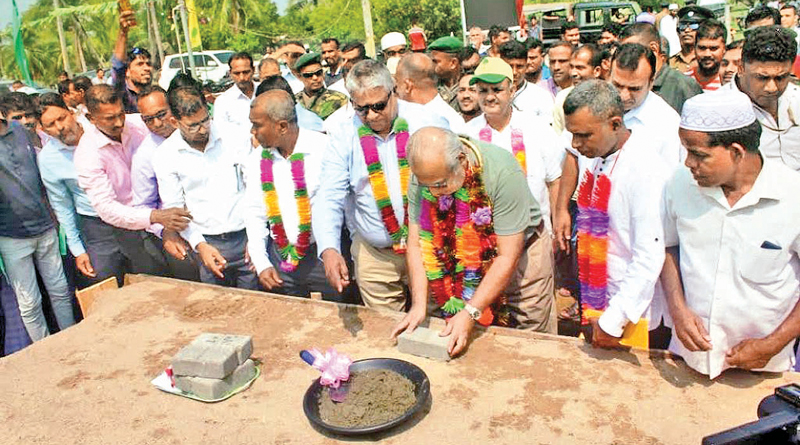 Minister Rauff Hakeem laying the foundation stone for the health centre. Picture by I.L.M. Rizan, Addalaichenai Central Corr.