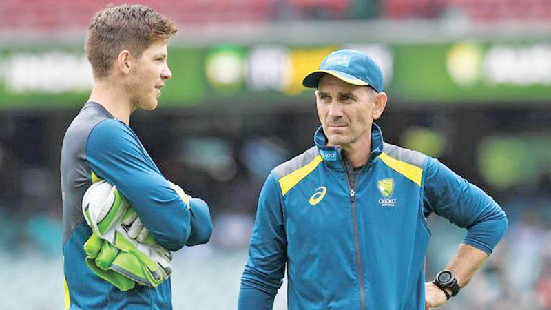 Australia's cricket coach Justin Langer (R) and captain Tim Paine.
