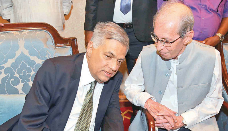 Prime Minister Ranil Wickremesinghe with Bradman Weerakoon, a former Secretary to seven Prime Ministers. Pictures by Hirantha Gunthilaka