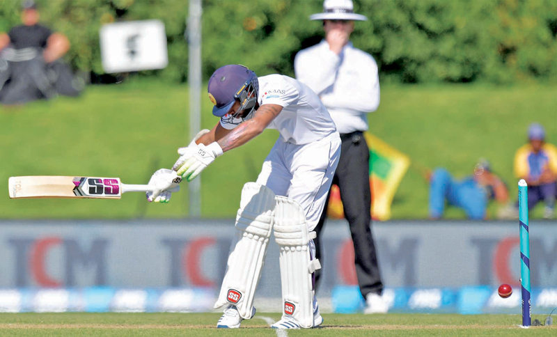 Sri Lanka's batsmen have been criticized by chief selector Ashantha de Mel for their poor techniques against the short-pitched ball. In the picture Niroshan Dickwella takes a blow on his body during the second Test against New Zealand at Christchurch. – AFP