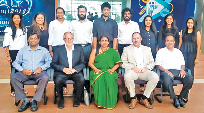 The first batch of Architecture students with their year masters, British examiners and the Head of School after their final portfolio exam
