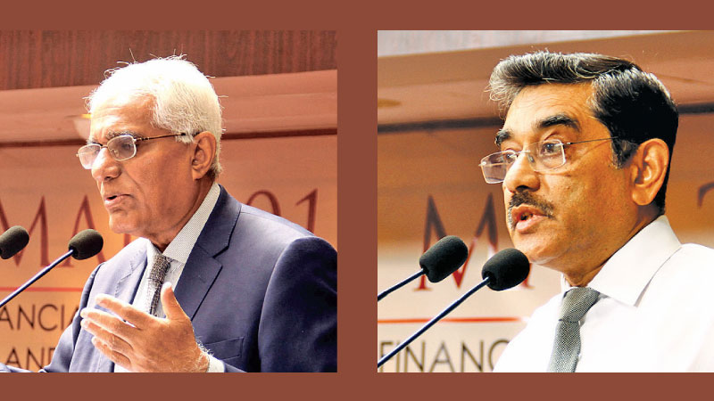 Dr. Governor, Central Bank, Indrajit Coomaraswamy and Senior Deputy Governor Dr. Nandalal Weerasinghe