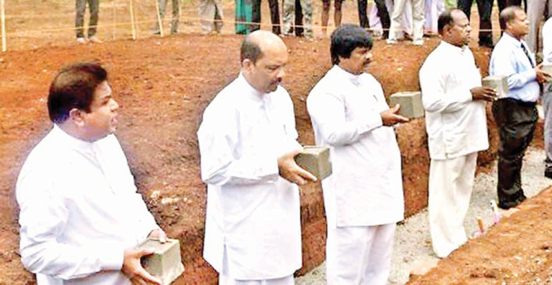 Irrigation Minister P. Harrison laying the foundation stone of the project.