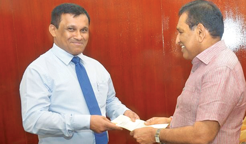 New Chairman of the State Pharmaceuticals Corporation (SPC) Dr. Rumi Mohammed receives his appointment letter from Health Minister Dr. Rajitha Senaratne.