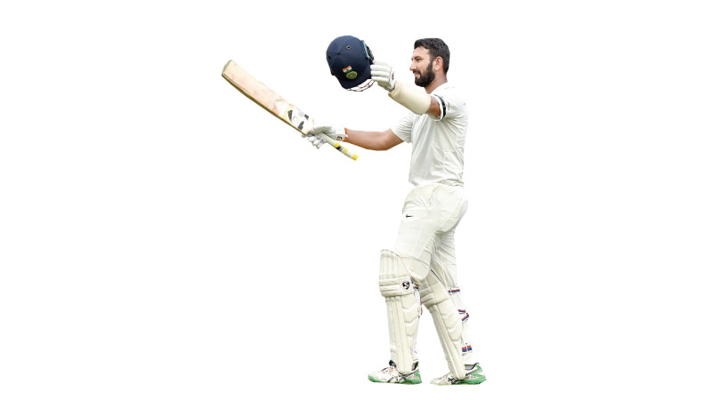 India's Cheteshwar Pujara celebrating his century against Australia during the first day of the fourth and final Test at Sydney  on Thursday. AFP