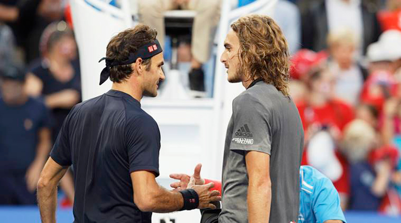 Roger Federer shakes hands with Greek youngster Stefanos Tsitsipas after beating him in straight sets.