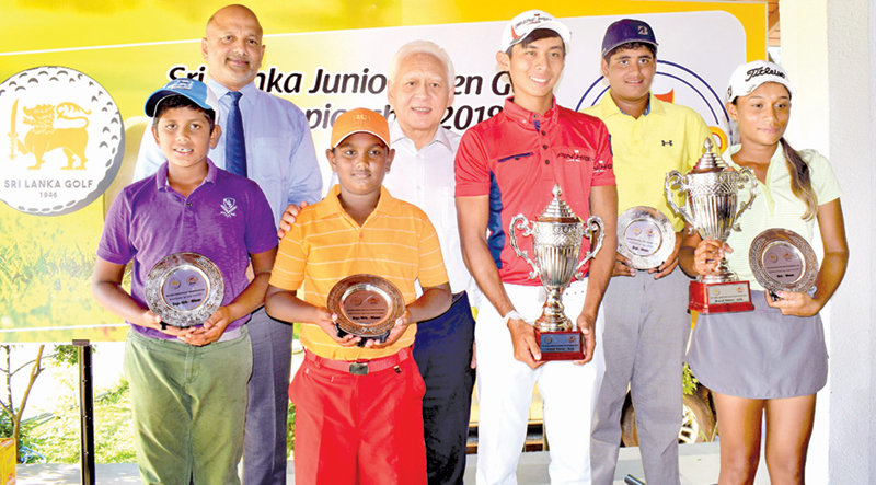 Junior golf championship winners Vinod Weerasinghe,Taniya Balasuriya and other champions are seen here with chief guest Shun Tien Shing General Manger Ceylon Agro Industries and Golf Union President Air Chief Marshal Harsha Abeywickrama. Picture by Herbert Perera