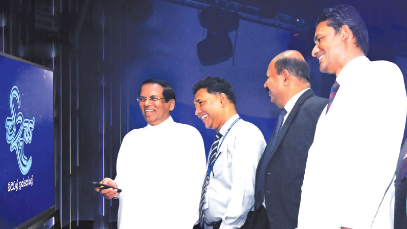 "President Maithripala Sirisena officially launching the ""Videsa"", a series of educational TV channels on PEO TV, at  Gampaha Bandaranaike Vidyalaya."