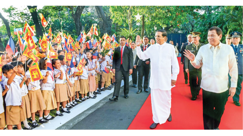 President Maithripala Sirisena who is in the Philippines on a four-day State visit was warmly welcomed by Philippines President Rodrigo Duterte at the Malacanang Palace yesterday. President Sirisena was accorded a Guard of Honour by the military prior to holding official talks with the Philippines President.  Five Memoranda of Understanding (MoUs) to improve mutual cooperation in the fields of security, economic affairs, tourism, agriculture and education were signed in the presence of President Sirisena an
