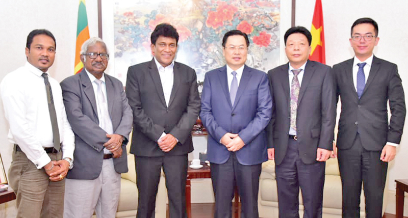 Chinese Ambassador Cheng Xueyuan and National Integration, Official Languages, Social Progress and Hindu Religious Affairs Minister Mano Ganesan along with officials after the discussion.