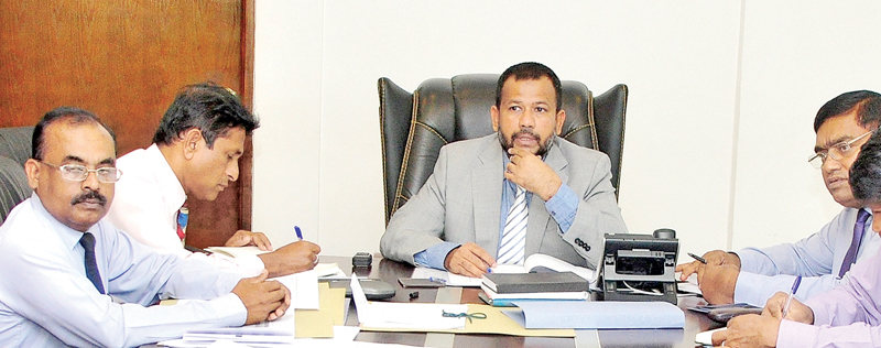 Minister of Industry and Commerce, Resettlement of Protracted Displaced Persons & Cooperative Development Rishad Bathiudeen (centre) discusses with Ministry Secretary KDN Ranjith Ashoka (right) and Registrar General of Companies D.N.R. Siriwardena (far left) on January 17 at the Ministry in Colombo 3.