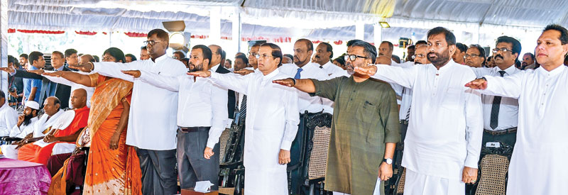 President Maithripala Sirisena launched the National Schools Drug Eradication Week at a ceremony at Mulliyawalai Vidyananda Vidyalaya, Mullaitivu yesterday. Here, President Sirisena joined by Ministers Daya Gamage and Rishad Bathiudeen, Northern Province Governor Dr. Suren Raghavan, SLFP General Secretary Parliamentarian Dayasiri Jayasekara seen taking the drug eradication oath. Picture by Sandaruwan Amarasinghe - President's Media Unit)