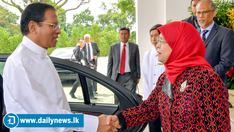 President Maithripala Sirisena, who is on a visit to Singapore to attend the Asia Pacific Forum of Environment Ministers and Heads of Environment Authorities being received by President of Singapore Halimah Yacob at the  Isthana Palace yesterday. Picture by Sudath Silva