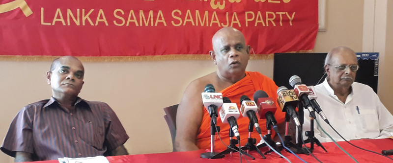 Lanka Sama Samaja Party (LSSP) Southern Provincial Councillor Ven. Baddegama Samitha Thera flanked by General Secretary Prof. Tissa Vitharana (right) and LSSP Deputy Secretary Anil de Soyza at the media conference yesterday.