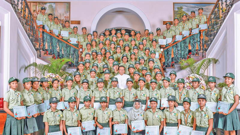 President Maithripala Sirisena with the 93 student Environment Pilots, after the awards ceremony, at President's House, on Wednesday. Picture courtesy President's Media Division