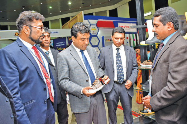 Deputy Minister of Development Strategies and International Trade Nalin Bandara, Industrial Development Board (IDB) Chairman Navin Adikarama and other officials at the Footwear and Leather Fair 2019, held at BMICH.