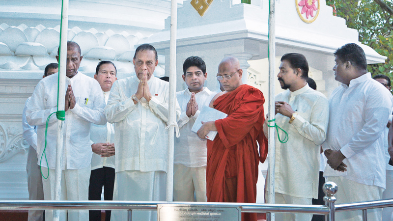 Speaker Karu Jayasuriya taking part in National Independence Day celebrations at the Polwatta temple in Copetty.