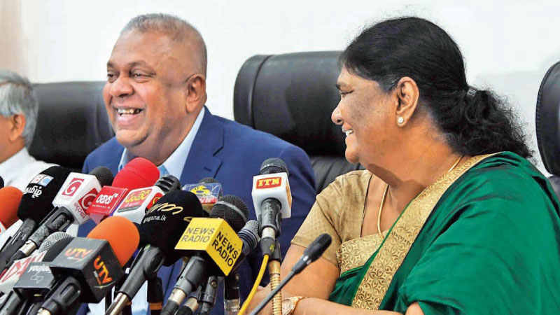 Finance and Mass Media Minister Mangala Samaraweera and Customs Director General P. S. M. Charles at the Finance Ministry auditorium.