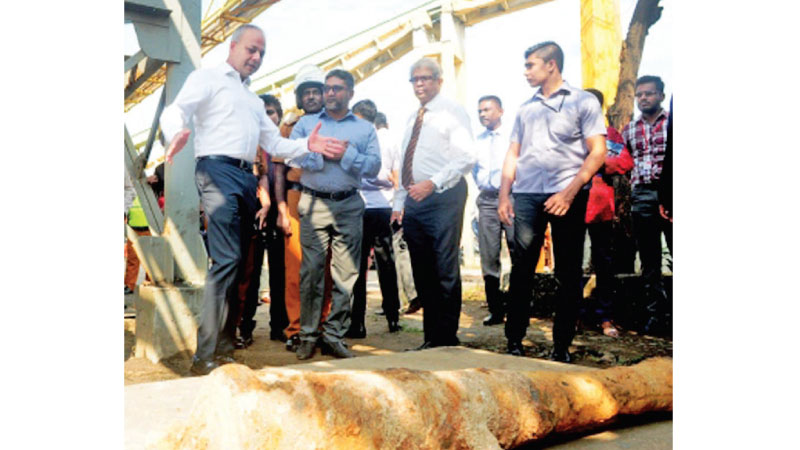 Minister of Ports and Shipping and Southern Development Sagala Ratnayaka on a visit to the Colombo Port yesterday. Picture by Wasitha Patabadi