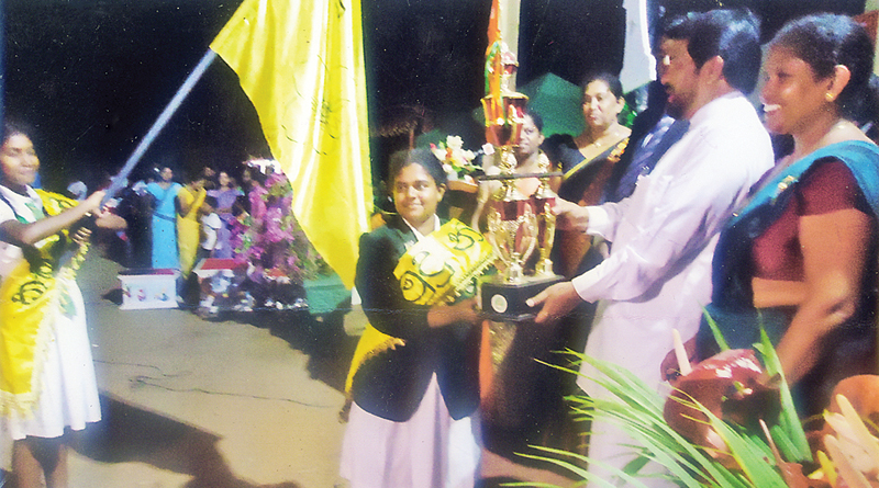 Western Province Education Minister Ranjith Somawansa handing over the challenge cup to the captain of Kumudu House. Principal Mrs M. K. M. S. Fernando is also in the picture.  Picture by S. R. Piyadasa. Wadduwa group