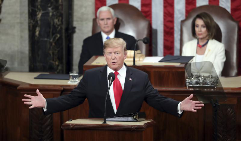 US President Donald Trump delivers his State of the Union address to a joint session of Congress on Capitol Hill in Washington on February 5, 2019 as Vice President Mike Pence and House Speaker Nancy Pelosi look on.