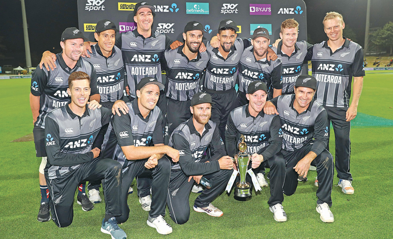 New Zealand players celebrate winning the third Twenty20 international cricket match between New Zealand and India in Hamilton on February 10. AFP