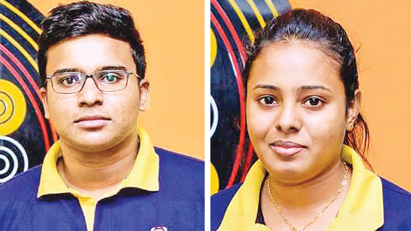 Men's carrom Champion Shaheed Hilmy and Women's carrom champion Chalani Liyanage