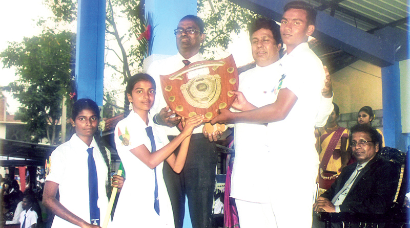 Kalutara District Parliamentarian and old boy of Wadduwa Central College, Jayantha Samaraweera with the Principal S. Dilan N. Gunarathna Presenting the overall Athletic Championship Trophy to Champion Vijaya House Captains M.H. Dilini Abeysinghe and W. Senith Mendis. Picture by H.L. Sunil Shantha Kalutra Central Special Corr.