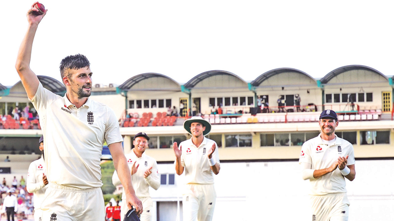 Mark Wood (L) of England walks off the field after taking five West Indies wickets for 41 runs during day 2 of the 3rd and final Test at Darren Sammy Cricket Ground, Gros Islet, Saint Lucia, on Sunday. – AFP