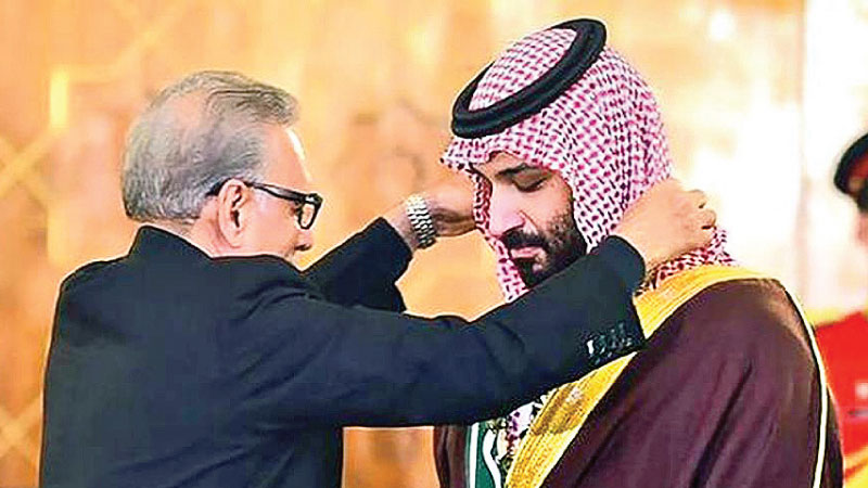 Pakistani President Arif Alvi conferring the country's highest civilian award, the Nishan-e-Pakistan, on Saudi Crown Prince Mohammed bin Salman in Islamabad on Monday.