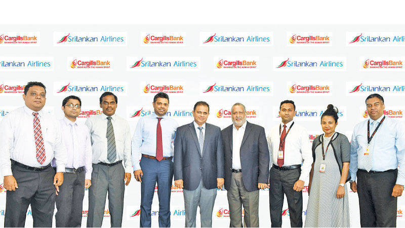 SriLankan Airlines team together with Cargills Bankteam after signing the agreement