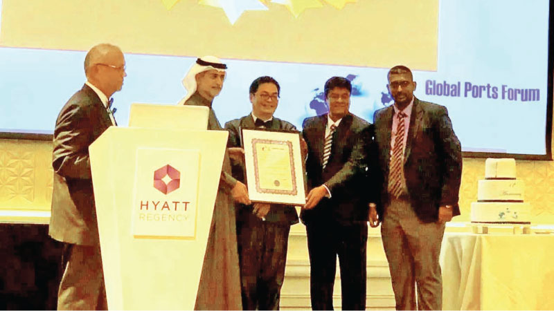 Upul Jayatissa – Director (Logistics, Marketing & Business Development) and Nalin Aponso - Chief Manager (Communication and Public Relations) of Sri Lanka Ports Authority (SLPA) receives the Ports Authority of the Year 2019 Award on behalf of the Sri Lanka Ports Authority (SLPA) from Mohammed Sharaf, Assistant Foreign Minister for Economic and Trade of UAE & former Group CEO, Dubai Ports World at the GPF awards ceremony