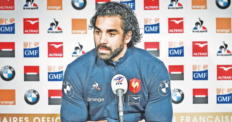 France's winger Yoann Huget speaks during a press conference in Marcoussis, southern Paris ahead of their Six nations Nations rugby union tournament match against Scotland. - AFP
