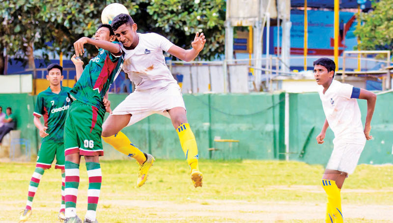 Royal College players in action against Zahira College Colombo in the Division I under 18 soccer tournament where Royal emerged runner-up.