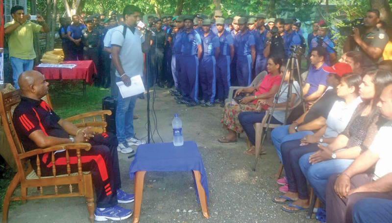 Kaduruduwa Welfare and Death Donation Society President Jayasantha de Alwis speaks to residents at the launch of the campaign, as Army Commander Lieutenant General Mahesh Senanayake looks on. Picture by Panadura Group Corr.