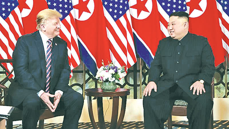 US President Donald Trump and North Korean leader Kim Jong Un meeting in Hanoi, Vietnam yesterday.