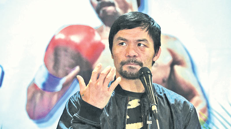 Boxing icon Manny Pacquiao said his wife was adamant their son must not box. AFP