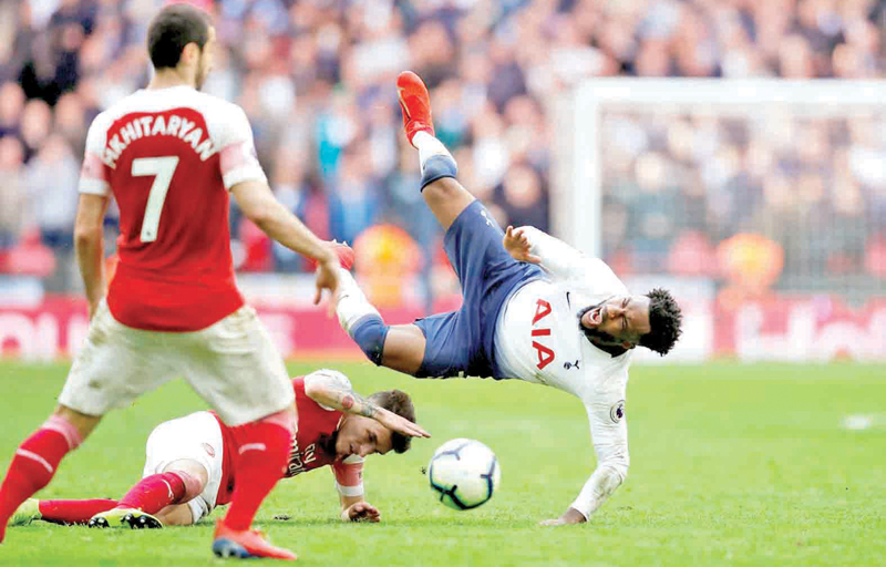 Arsenal's Lucas Torreira is sent off for this challenge on Tottenham's Danny Rose in the Premier League match played on Saturday.