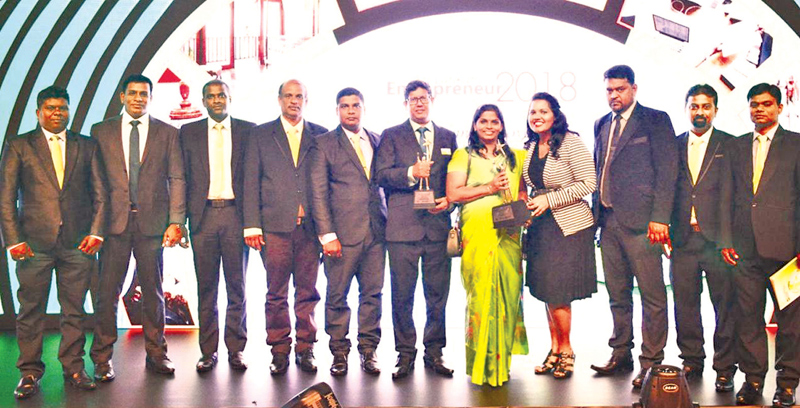 Petform Chairman and Managing Director P. Mathytharan, his spouse and some of the Petform staff with the awards.