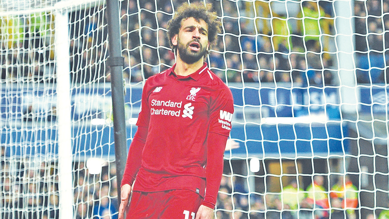Mohamed Salah missed two huge chances as Liverpool were held 0-0 at Everton on Sunday. AFP