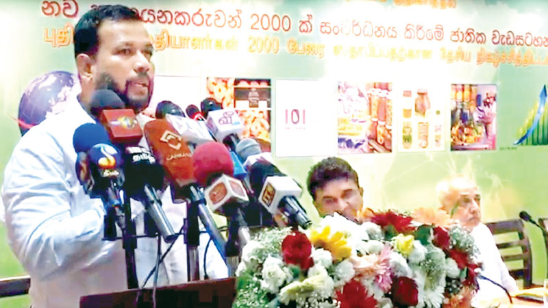 Minister of Industry Commerce, Rishad Bathiudeen addresses the seventh awareness session of SLEDB's '2000 New Exporters Programme' Minister of Development Strategies and International Trade Malik Samarawickrama looks on