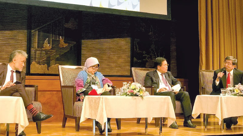ICA Vice President for Human Security and Global Health Mr. Takao Toda; Head of Policy Working Group on Health Insurance under the Office of the Vice President of Indonesia Ms. Prastuti Soewondo; Lao People's Democratic Republic Minister of Health Dr. Bounkong Syhavong; and ADB President Mr. Takehiko Nakao.