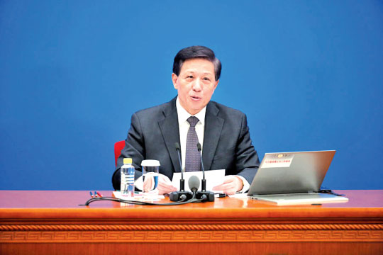 Zhang Yesui, spokesman for the second session of the 13th National People's Congress. [Photo by Kuang Linhua/chinadaily.com.cn]