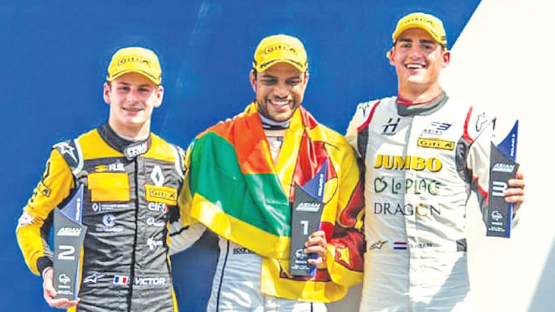 Winner Eshan Pieris (centre) with second and third place winners on the podium