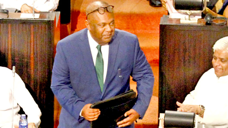 Minister Mangala Samaraweera entering the Parliament to present the 2019 Budget yesterday.  Picture by Sulochana Gamage
