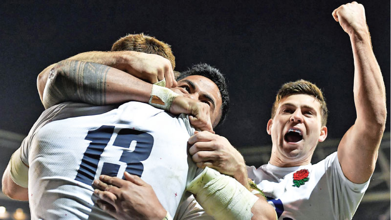 England's Henry Slade celebrates with Manu Tuilagi after scoring their third try.